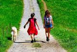 Due ragazze nei campi con il cane - 219766845