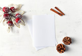 An arrangement of Christmas decorations and blank paper cards on white wooden background. Flatlay. Copy space - 219767402