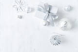 Christmas present with white and silver Christmas decorations. Flatlay. Copy space - 219767445