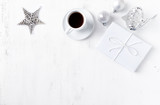 Christmas present, ornaments and a cup of coffee on white painted wooden background. Symbolic image. Flatlay. Copy space - 219767458