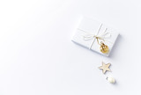 Christmas present with Christmas decorations on white background. Flatlay.  Symbolic image. Copy space - 219767470