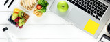 Fototapety Healthy food in meal box set on working table with laptop