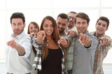 group of young people pointing at you