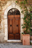 Old wooden door in Tuscany, Italy - 219777092