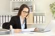 Office worker wearing eyeglasses working online