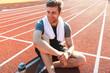 Leinwanddruck Bild - Smiling sportsman finished running at the stadium