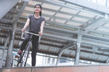 Sport woman is posting with her bike on the stair © junce11
