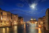 The moon shines over Venice. Picture taken from the Academy bridge. Italy.