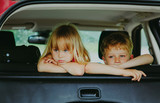 little girl and boy waiting in car bored sad tired - 219793267
