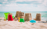 Sand castle on the beach, vacation concept