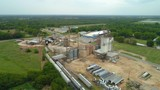 Industrial farm equipment aerial drone flyover and tilt down - 219813880