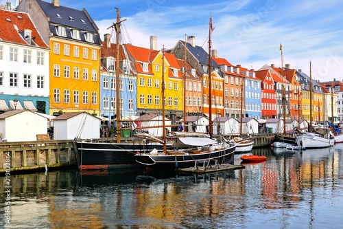 Colorful waterfront buildings and ships along the historic Nyhavn canal, Copenhagen, Denmark