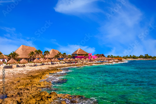 Colorful Huts on Rocky Beach