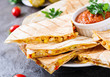 Mexican Quesadilla wrap with chicken, corn and sweet pepper and tomato sauce - 219828485