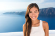 Beautiful Asian young woman smiling portrait in sunshine. Gorgeous Chinese Caucasian model in summer outdoors, Europe travel destination, luxury Santorini Greece getaway.