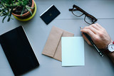 desk office work corporate business finance tablet letter hand man watch glasses letter paper pen plant - 219880474