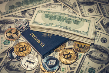 Stack of hundred dollar bills on the United States passport and cryptocurrency coins