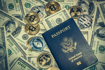 Cryptocurrency coins and United States passport on one hundred dollar bills