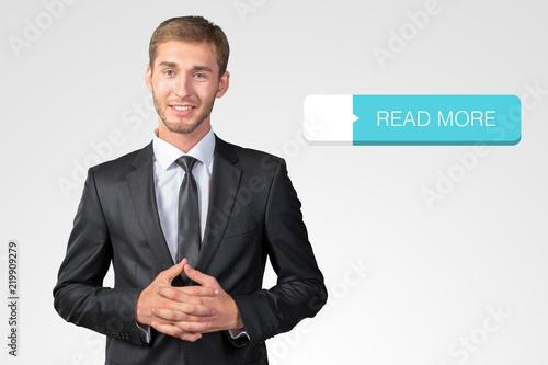 Naklejka Young handsome businessman smiling