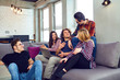 A group of young people have fun chatting at a meeting of friends.