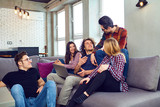 A group of young people have fun chatting at a meeting of friends. - 219911858