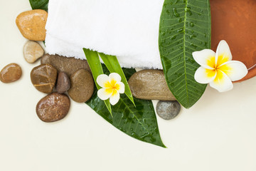 Beautiful spa composition (stones, flowers, leaves) on white background © millaf
