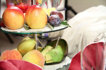 Fruits and avocado on a tray in a hotel room. © VideoStockFactory