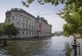 Bode Museum on the Museum Island in the river spree  Berlin against a blue sky, famous landmark in the central Mitte district in the capital city of Germany - 219941413