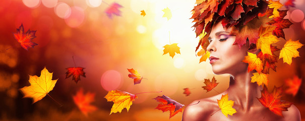 Autumn Beautiful Woman With Falling Leaves Over Nature Background