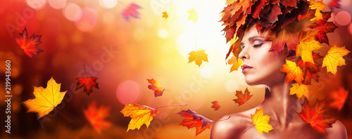 Autumn Beautiful Woman With Falling Leaves Over Nature Background - 219943660