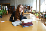 female student in the library - 219957683
