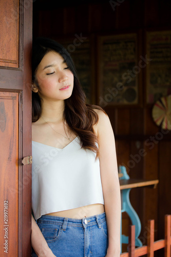 220d261ca42 Portrait of thai china adult beautiful girl White shirt blue jeans relax  and smile
