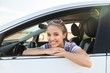 Leinwanddruck Bild - Portrait of Smiling Young Woman in her Car