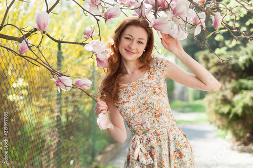 Young ginger hair woman near light pink tender blossoming tree. fairy  dreamlike mood of the e1274809c