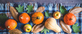 Hello, Autumn. Orange pumpkins Apples Autumn foliage Plaid on a wooden background