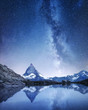 Matterhorn and reflection on the water surface at the night time. Milky way above Matterhorn, Switzerland. Beautiful natural landscape in the Switzerland - 220005676