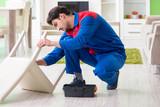 Repair contractor repairing broken chair at home - 220009606