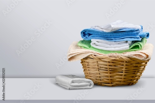 Leinwandbild Motiv Laundry Basket with colorful towels on background