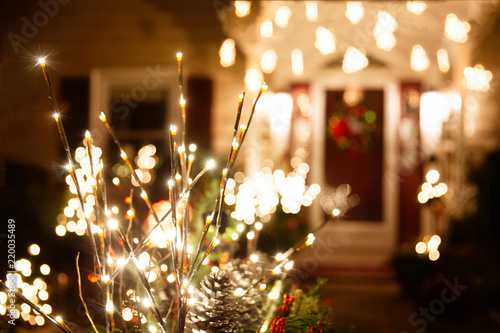 Leinwandbild Motiv shining Christmas decorations outside the house. beautiful glowing Christmas composition of fir branches and cones outside