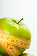 Green Apple Wrapped With Tape Measure Close-up
