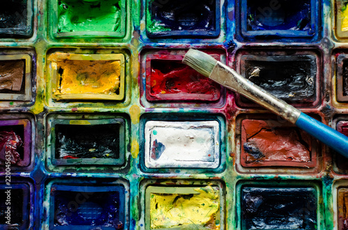 Artist paint brush and watercolor paintbox © Nelly Kovalchuk
