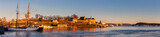 Panorama of Oslo city skyline and harbor in front of Akershus Fortress during sunset in Norway