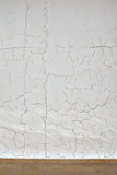 Pattern of cracks on the white plaster coated wall, textured background - 220049642