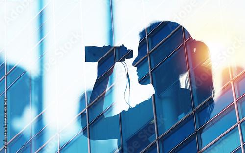 Leinwanddruck Bild Businessman looks for new job opportunities with binoculars. double exposure