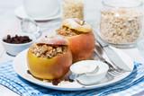 healthy breakfast. oatmeal baked in apple - 220067627