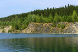 lake with wooded steep banks - a submerged old worked-out quarry - 220073454