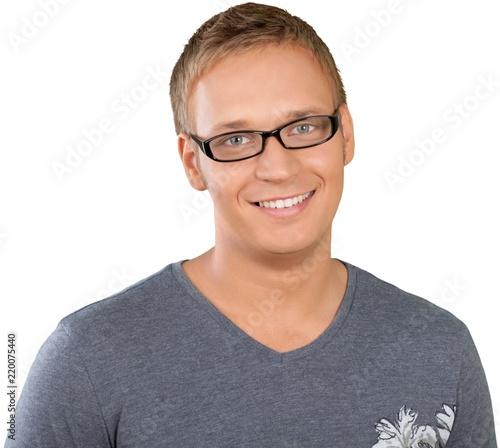 Leinwandbild Motiv Portrait photograph of a caucasian man in glasses smiling