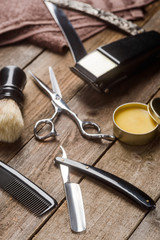 Wax, straight razor and scissors