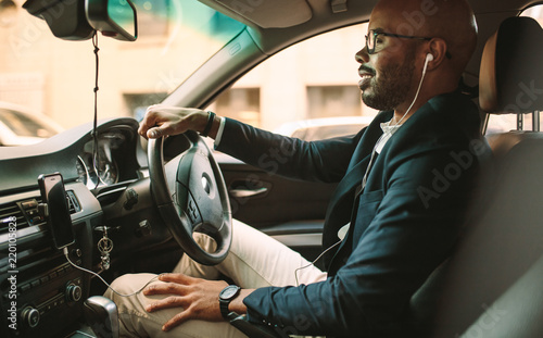 Poster African businessman driving a vehicle to office