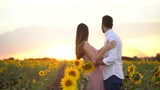 Romantic Couple on a Love Moment in a Sunflower field - 220129045